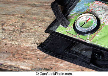 Compass on topographic map. Concept of travel.