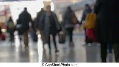 Crowd of people walking at the station - Defocused shot of...