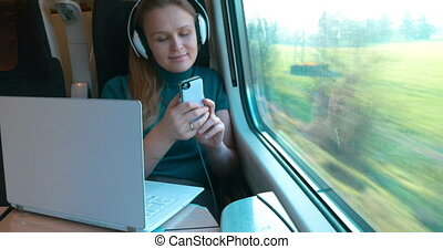 She always taking all devices in the trip - Modern female...