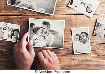 Photos on a table - Black and white family photos laid on...