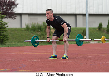 Young Man Doing A Deadlift Exercise Outdoor