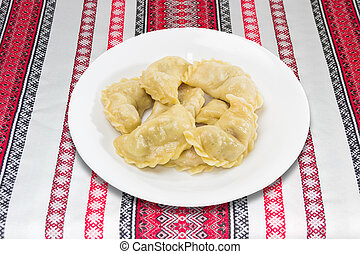 Varenyky - Ukrainian boiled varenyky dumplings filled with...