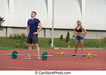 Young People Doing A Overhead Squat Exercise Outdoor