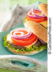 burger with beef patty cheese lettuce onion tomato