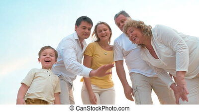 Close-Knit Family Putting Hands Together - Steadicam shot of...