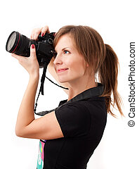 Young woman photographer - Pretty girl making photo using...