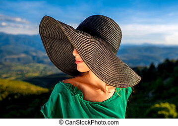 Woman with hat in the mountains - Young woman in big hat and...