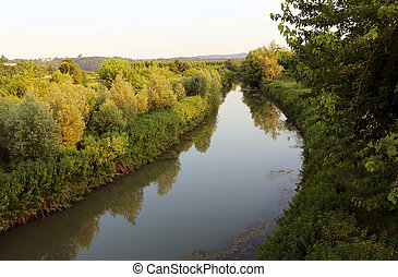 river in the middle of the countryside in Northern Italy -...