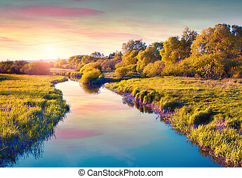 Colorful summer sunrise on the river.