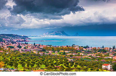 Rain clouds over the northern coast of Sicily. View from the...