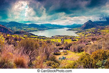 Dramatic rain clouds over lake Rosamarina, Sicily, Italy,...