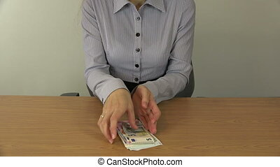 business woman money - Business woman in shirt take and hold...