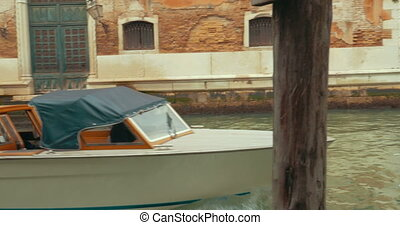 Touristic boats sailing on canal of Venice - Steadicam shot...