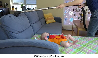 woman clean sofa baby - Cute newborn baby in orange body...