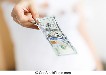 Hand of woman giving money on the white background