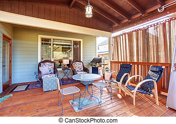 Gorgeous back yard with large covered porch.