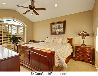 Beautiful bedroom with striped bedding. - Beautiful bedroom...