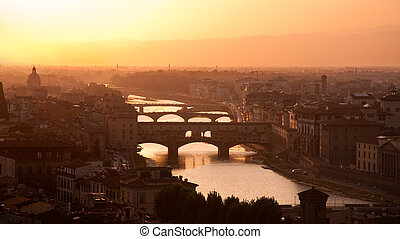Florence skyline at sunset, Italy. Ponte Vecchio sull\'Arno.