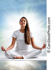 Woman meditating. - Close up portrait of attractive young...