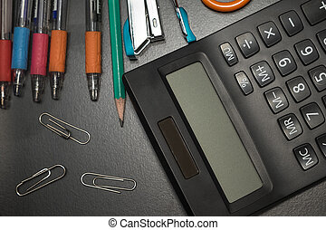 closeup office stationery on black background, back to...