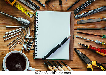 tools equipment with coffee and notebook on wood