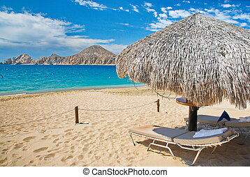 Mexico Beach - Beachside palapa shelter and lounge chairs...