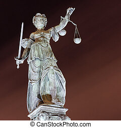 Lady Justice by night in Frankfurt Germany