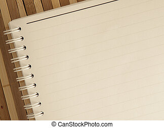 blank notepad notebook with pencil on brown bamboo...