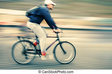 Abstract image of cyclist on the city roadway. Intentional...