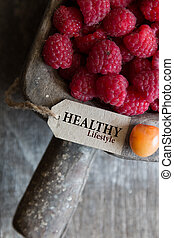 healthy lifestyle, raspberries and a tag with the...
