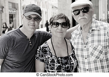 Happy loving senior parents with adult son