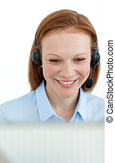 Portrait of a smiling business woman at a computer