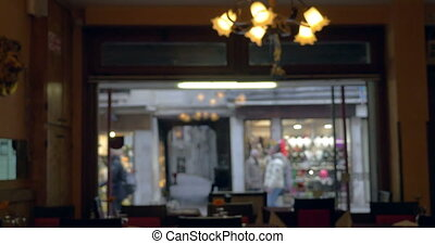 View to the street through window of cafe or restaurant -...