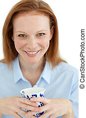 Portrait of a smiling businesswoman holding a cup of tea