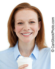 Smiling businesswoman drinking a coffee