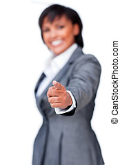 Smiling hispanic businesswoman pointing