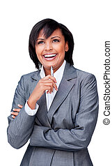 Laughing hispanic businesswoman holding a pen