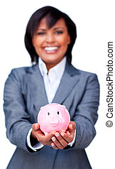 Hispanic Businesswoman holding a piggybank