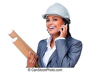 Female architect on phone bringing blueprints