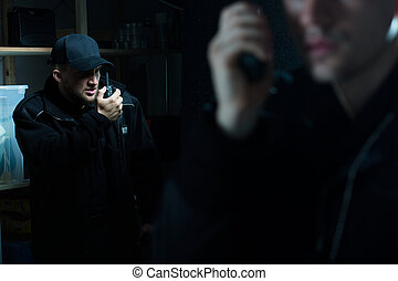 Officers calling for back up - Photo of police officers...