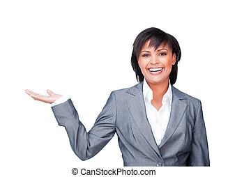 Young businesswoman with open palm smiling at the camera