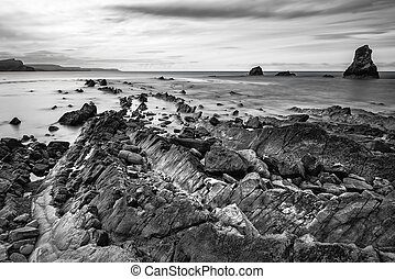 Stunning tonal black and white landscape of Mupe Bay with...