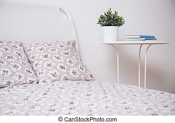 White bed and nightstand - Cozy bedroom with with bed and...