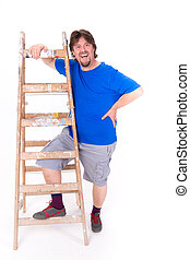 Happy smilng man standing next to a ladder