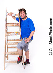 Laughing man standing next to a ladder