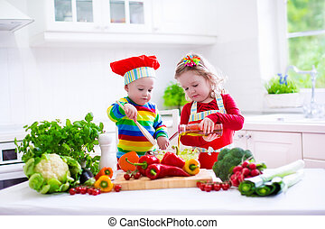 Kids cooking healthy vegetarian lunch - Kids cooking fresh...