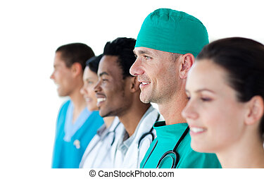 Multi-ethnic medical group standing in a line isolated on a...