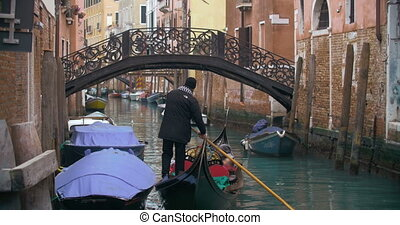 Traveling by gondola on Venice canal - Gondola with people...
