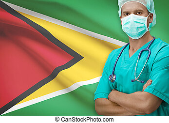 Surgeon with flag on background series - Guyana - Surgeon...