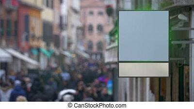 Blank billboard hanging in busy street